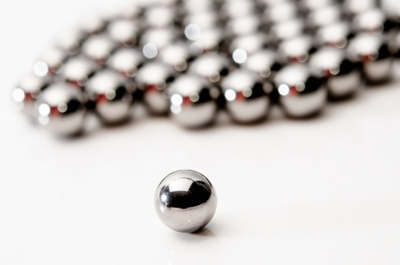 Metallic bearing balls on white background