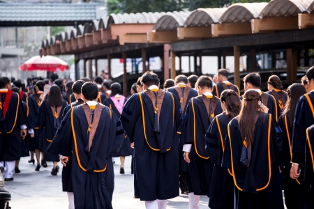 BANGKOK - March 1, 2012: Bangkok, Thailand. graduates of the Ramkumheang University walk towards Convocation Hall to receive their diplomas on March 1, 2013. Editorial