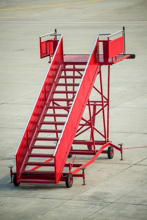 gangway: A red gangway of the plane at the airport