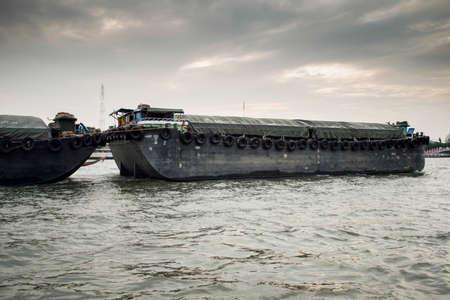 praya: A big boat carry rice in Chao Praya River ,Bangkok,Thailand