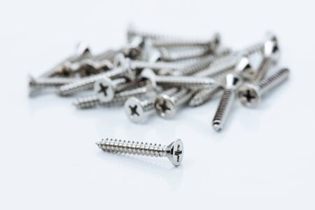 Screw on white Stock Photo