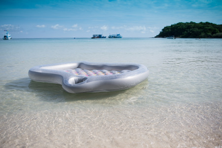 the mattress floating on the beach