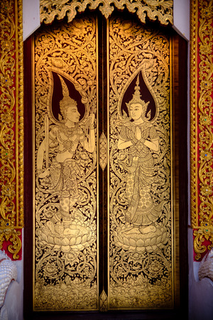 beautiful golden Thai painting on the door in tample, chiang-mai, thailand Stock Photo
