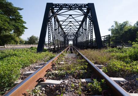 old rail way bridge with grass