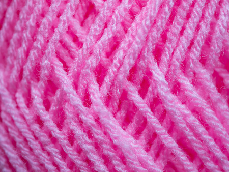 used clothes: The pink yarn used for knitting clothes Stock Photo