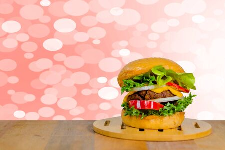 Hamburger on a wooden tray and put on a wooden table