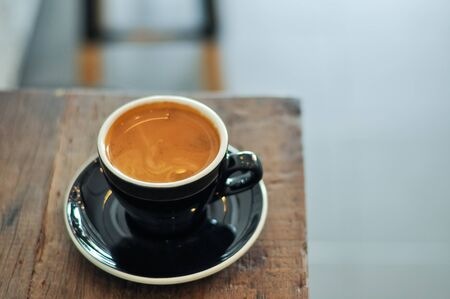 full bodied: Rich full bodied Americano coffee in a cup on wooden table