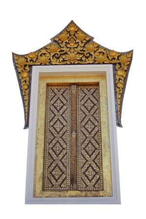 Gold carved ancient window of temple Thailand. photo