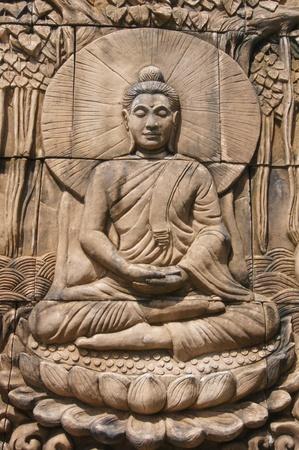 Historic sandstone Buddha statue. Thai temples.