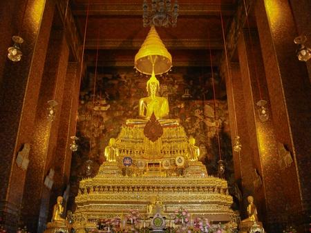 awakened: Golden Buddha image in Buddhist temple Stock Photo