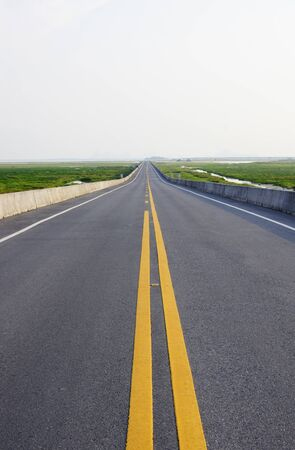Empty curved road photo