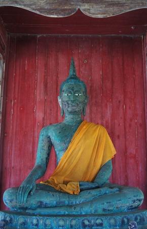 Buddha, ancient green rust. Stock Photo - 12011578