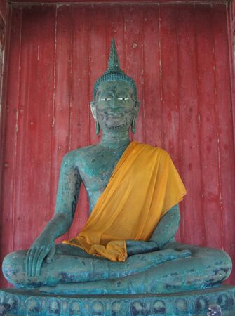 Buddha, ancient green rust. photo
