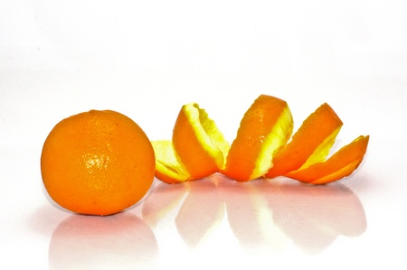 Spiral orange peel reflecting on white background. photo