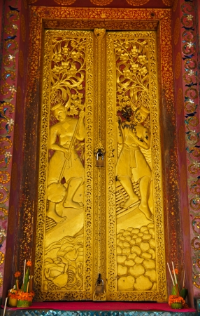 Gold carved ancient window of temple   photo