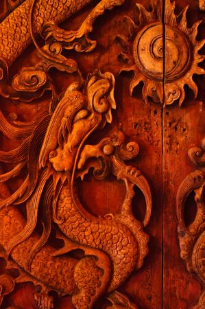Antique wooden door, Sculpt a Dragon God  photo