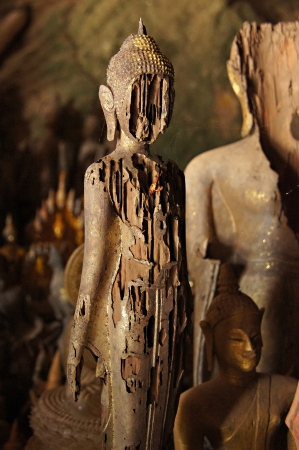 ou: Antique carved wooden Buddha at Pak Ou Caves, Laos