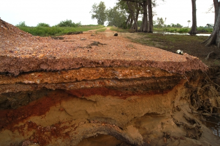lumpy: Road erosion from storms and waves. Stock Photo