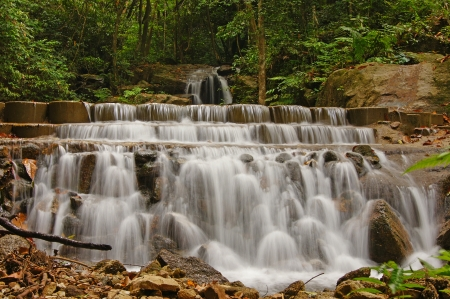 Nice small waterfall in deep forest photo