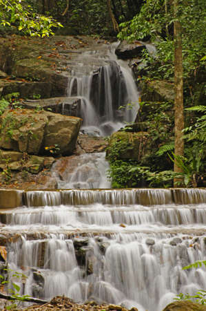 Nice small waterfall in deep forest Stock Photo - 16152917