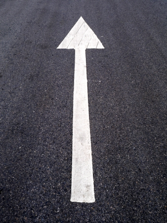 White arrow on the road surface  photo