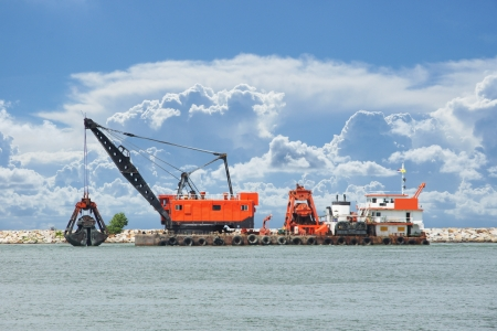 Floating dredging platform on the sea photo