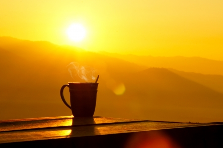 Silhouettes on sunrise morning coffee