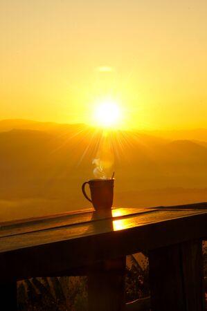 Silhouettes on sunrise morning coffee