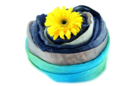 Hand woven fabrics and African daisy (gerbera). photo
