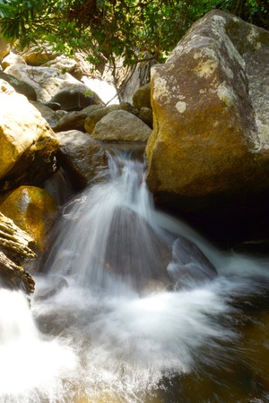 Small Waterfalls flowing over the rock. photo