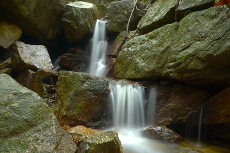 Beautiful of small waterfall flowing over the rock  in the forest. Stock Photo - 20643625