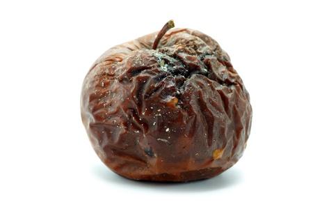 putrefy: Rotten apple. Isolated on white. Stock Photo