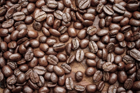 jamoke: Coffee beans on the wooden background. Stock Photo