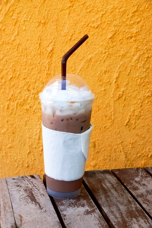 Ice coffee on a wooden table photo