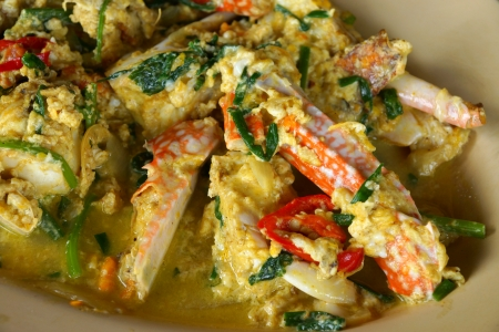 blue swimmer crab: Stirred Fried Crab with Garlic, Pepper, Curry Powder. Stock Photo