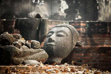 Head of Sandstone Buddha at Wat Mahathat, Ayutthaya, Thailand photo