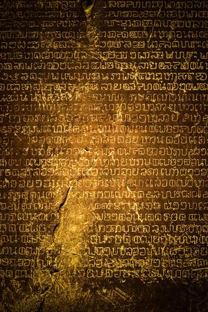 Ancient Thai writing chiseled on stone