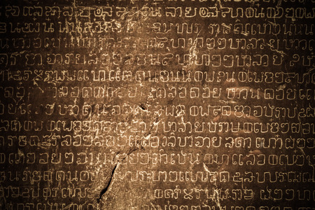 inscription: Ancient Thai writing chiseled on stone
