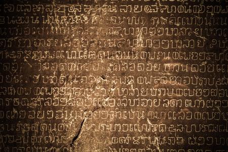 Starożytny tajski pisanie rzeźbiona w kamieniu Zdjęcie Seryjne