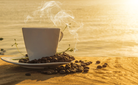 morning coffee: Silhouettes of morning coffee on the lake. Stock Photo
