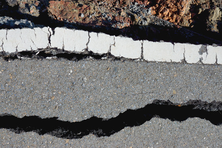 crevice: Fissures and erosion of the asphalt road by the earthquake.
