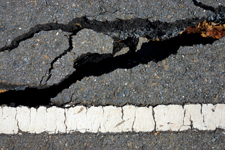 fissures: Fissures and erosion of the asphalt road by the earthquake.