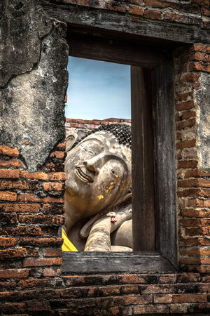 asian art: Asian religious art. Ancient sandstone sculpture of Buddha at Ayutthaya, Thailand