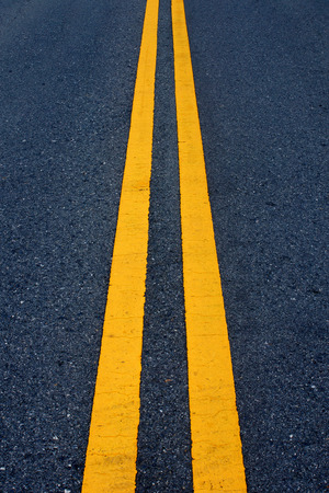 Two yellow traffic lines on the road. photo