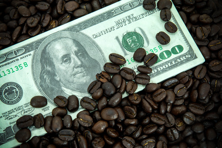 Roasted coffee beans and Money photo