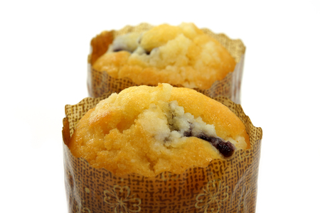 Blueberry muffins on white background photo