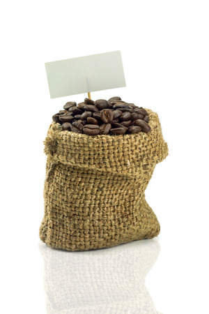 Coffee Beans in a Bag and paper tag. photo