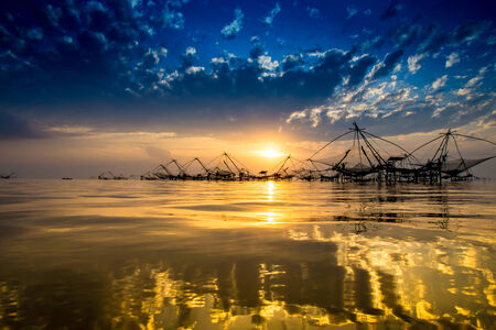 Silhouette of bamboo machinery in the lake. South of Thailand. photo