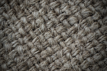 roughly: roughly woven, coarse grain, burlap grunge texture.