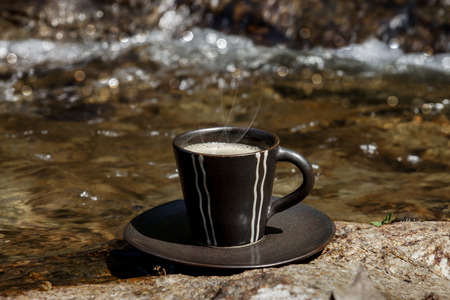 refreshments: Refreshments and coffee on the rocks at the waterfalls.